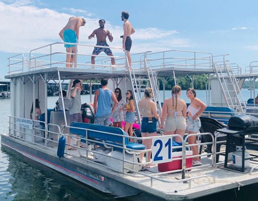 Chris Perrine on pontoon boat (Source Instagram)